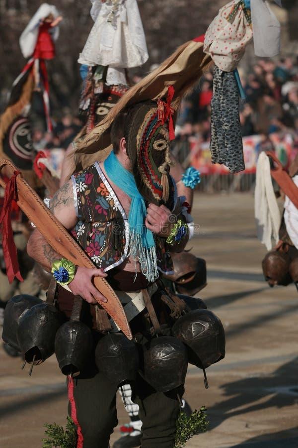 Masquerade festival Surva in Pernik. PERNIK, BULGARIA - JANUARY 30, 2016 - Masquerade festival Surva in Pernik, Bulgaria. People with mask called Kukeri dance royalty free stock images