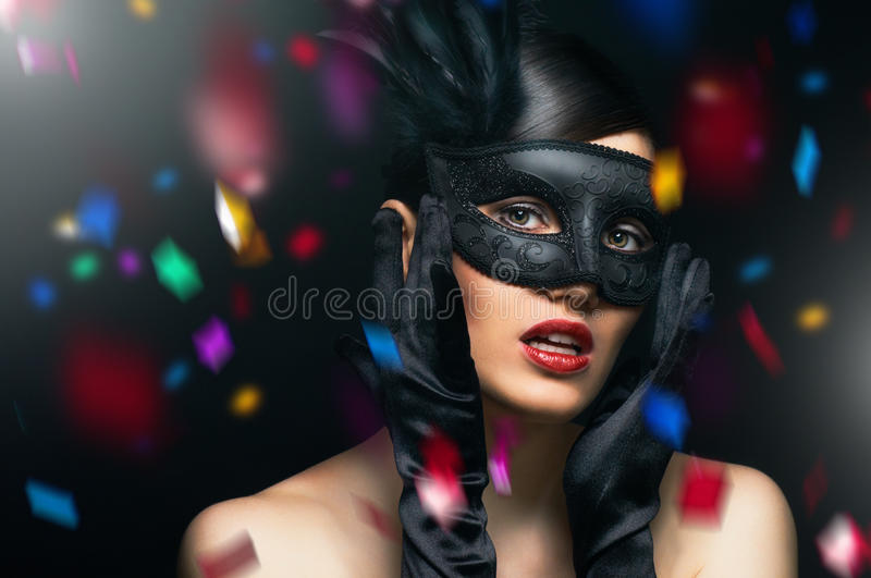 Masquerade mask. Cute girl in masquerade mask