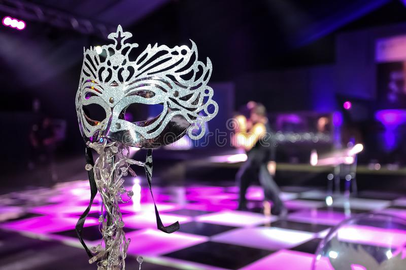 Masquerade Mask at corporate event or gala dinner. Pink and Purple Blue Decor Masquerade Mask at corporate event or gala dinner stock photos