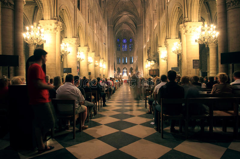 Mass celebration in notre dame stock photography