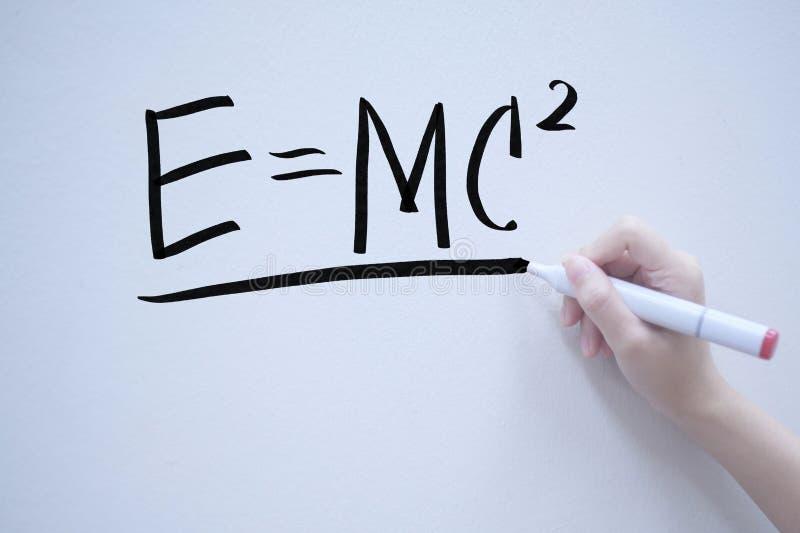 mass-energy equivalent handwriting on whiteboard royalty free stock photo