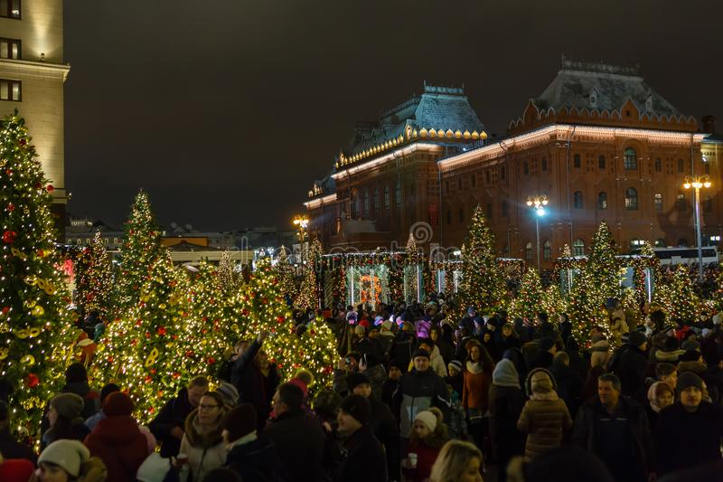 Mass festivities of citizens on the decorated and illuminated do stock photo
