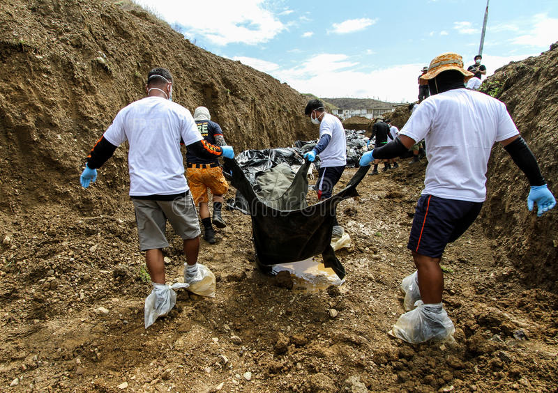 Mass grave for victims of typhoon Haiyan in Philippines. Tacloban City, Philippines- November 17, 2913:A total of 393 cadavers, in black bags, were laid in a stock images