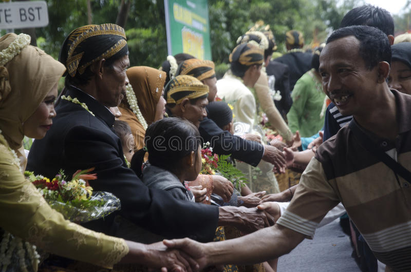 MASS MARRIAGE FOR POOR. Grooms and brides from poor community on a mass marriage ceremony held by a social activism agency at Solo, Java, Indonesia. Rising stock photo
