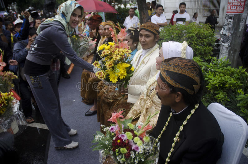MASS MARRIAGE FOR POOR. Grooms and brides from poor community on a mass marriage ceremony held by a social activism agency at Solo, Java, Indonesia. Rising stock photos