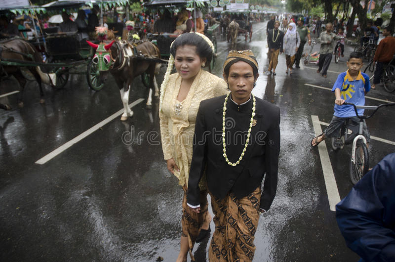 MASS MARRIAGE FOR POOR. Grooms and brides from poor community on a mass marriage ceremony held by a social activism agency at Solo, Java, Indonesia. Rising royalty free stock photos