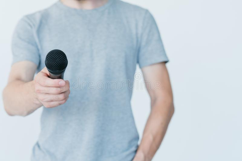 Mass media journalism broadcast hold mic interview. Mass media information and journalism concept. male broadcaster holding microphone as if conducting interview stock photo