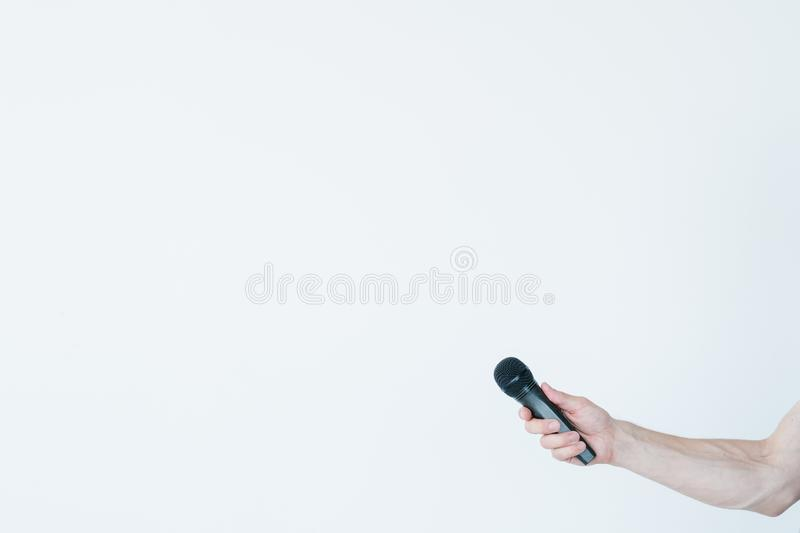 Mass media journalism man hand hold mic interview stock photography