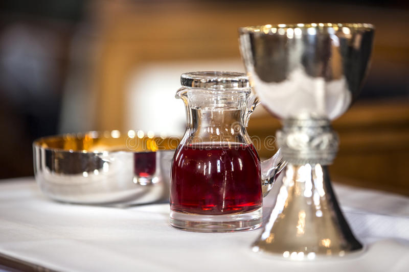 Mass offerings. Catholic Mass offerings, gifts with a wine in focus royalty free stock photography