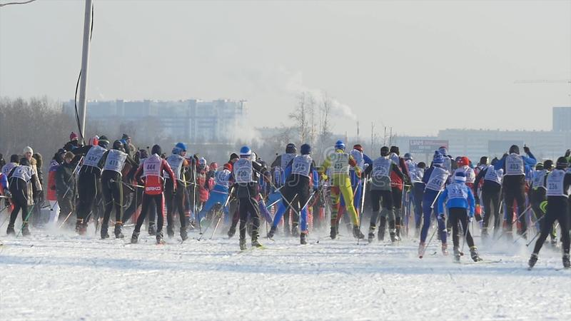 Mass start men athletes skiers during Championship on cross country skiing stock image