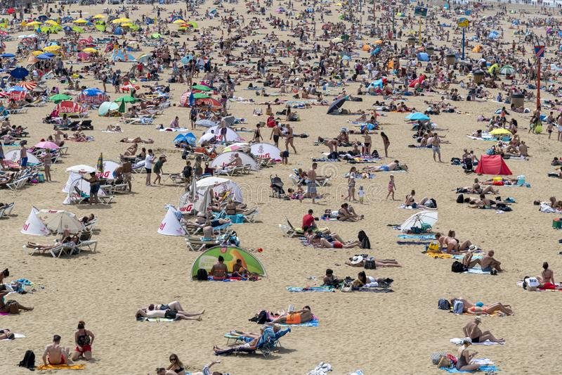 Mass summer tourists on the European beaches stock photography