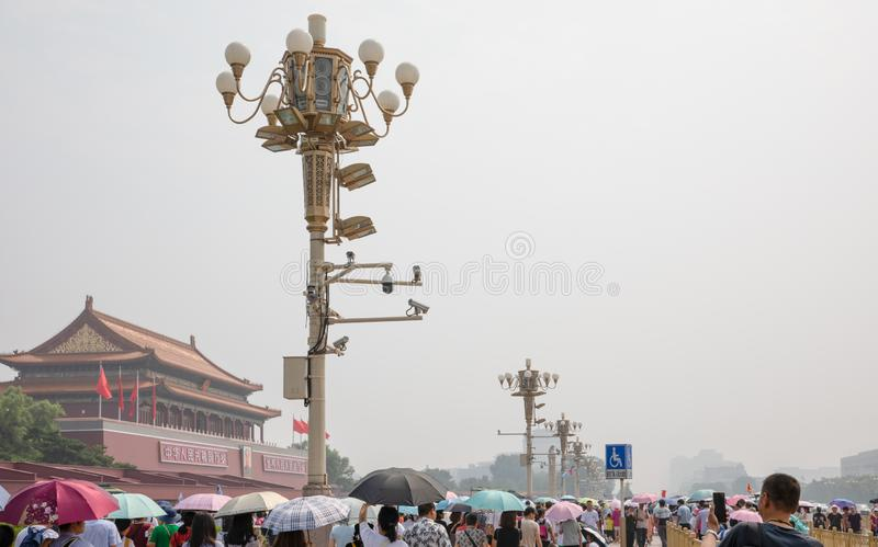 Mass tourists around the Tiananmen Gate Tower in a hot, hazy summer day in Beijing royalty free stock photo
