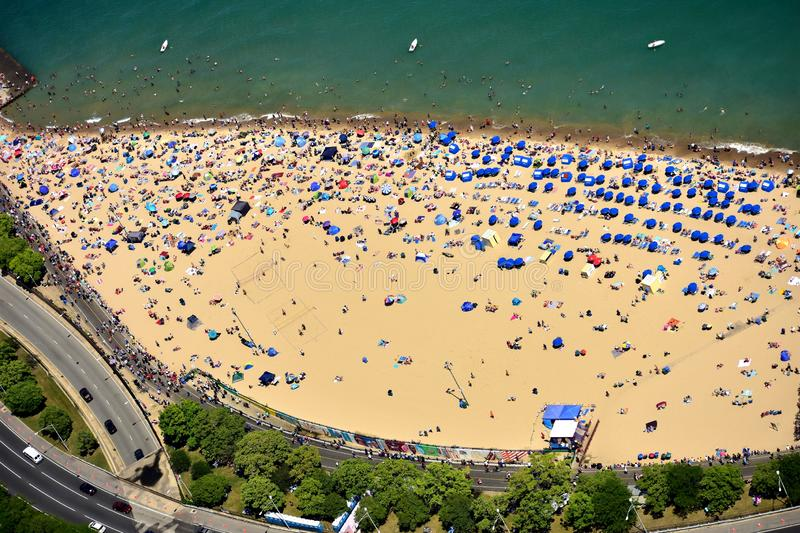 Mass tourists at Oak Street beach in Chicago, IL. USA royalty free stock photography