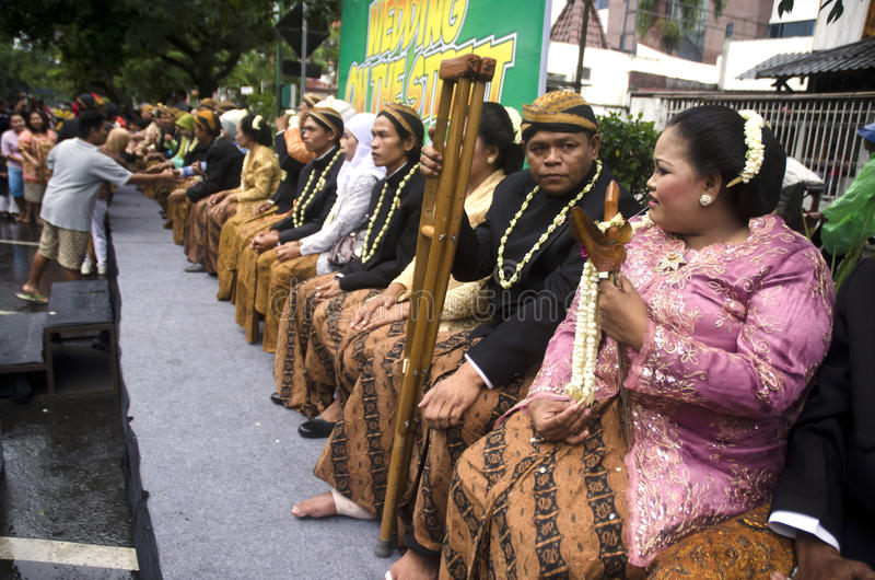 MASS WEDDING FOR POOR INDONESIAN. A mass wedding ceremony for those who can not afford it held by a social NGO in Solo, Java, Indonesia. Over 65 million royalty free stock photos