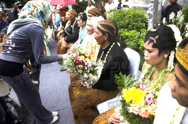 MASS WEDDING FOR POOR INDONESIAN. A mass wedding ceremony for those who can not afford it held by a social NGO in Solo, Java, Indonesia. Over 65 million stock photos