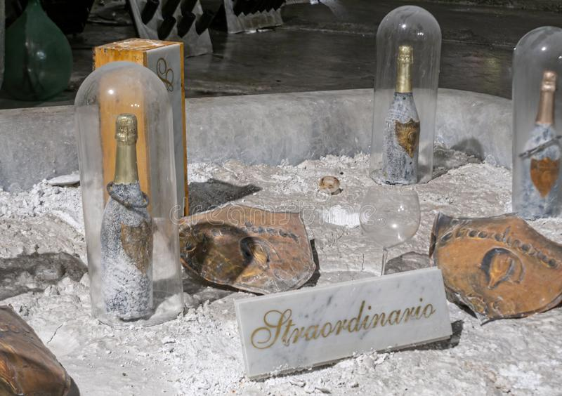 MASSA CARRARA, AUGUST 23, 2019 - lo Straordinario sparkling wine, aging inside the quarry at Fantiscritti. Grapes from stock images