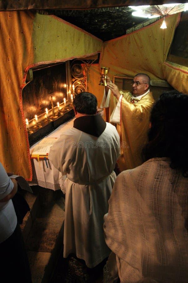 Massa in een Grot van Geboorte van Christus, Bethlehem, Israël stock foto's