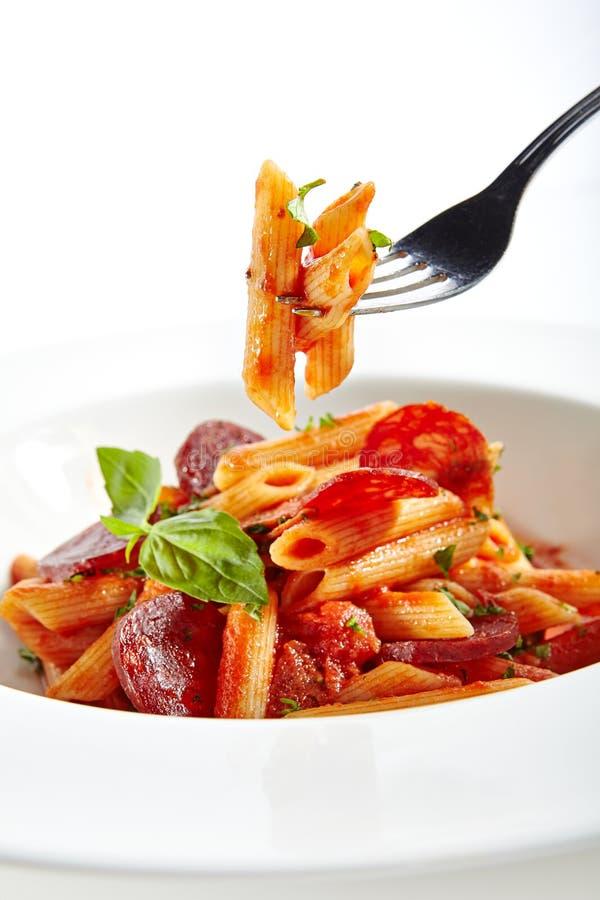 Massa italiana com salame imagem de stock