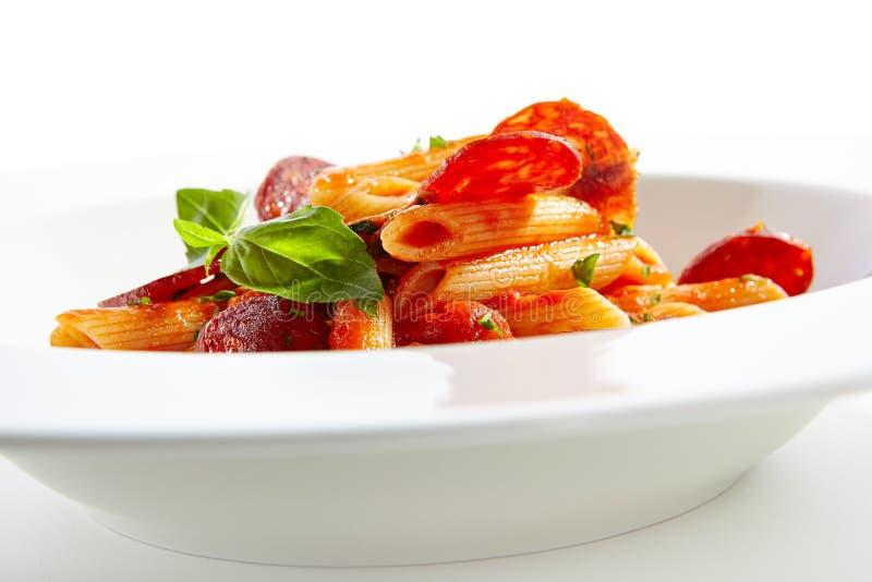 Massa italiana com salame foto de stock