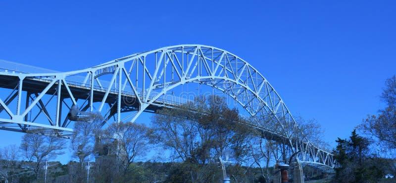 Sagamore Bridge over Cape Cod Canal under bright blue skies stock photo