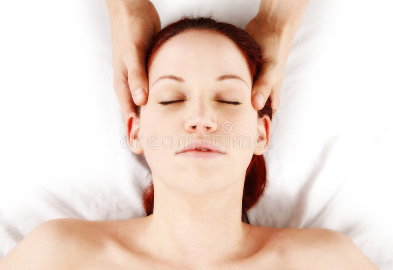 Massage. Woman getting head and neck massage by therapist royalty free stock photo