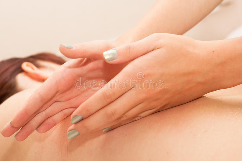 Massage. A woman receiving a massage royalty free stock image
