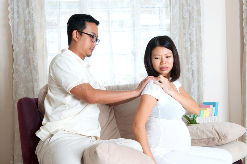 Massage. Asian men massage for her pregnant wife stock photos