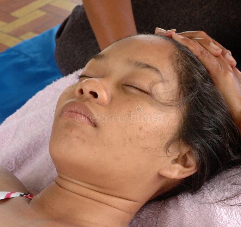 Massage at the Beach (head massage). Beach massage by Thailand massage girl stock image
