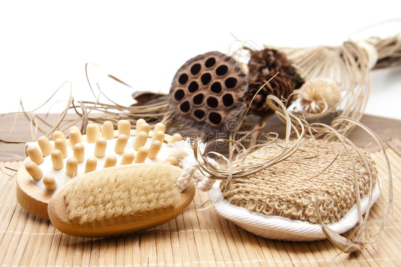 Massage brush and nailbrush. With sponge and dry flowers royalty free stock images