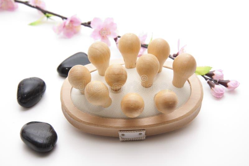 Massage brush with stones royalty free stock image