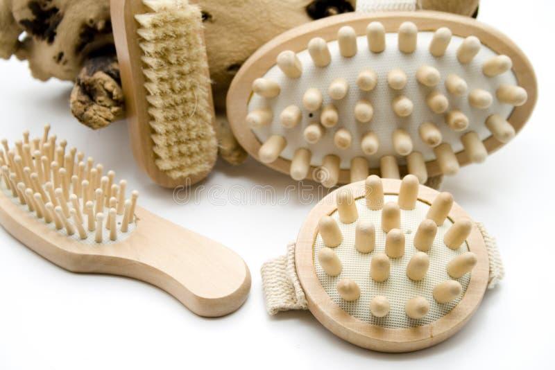Massage brushes and nailbrush with hairbrush. On white background royalty free stock photo