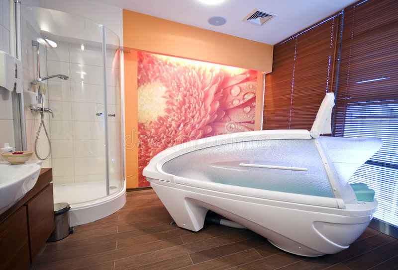 Massage cabin. A modern massage room with a comfortable cabin, a shower and cosmetics stock photo