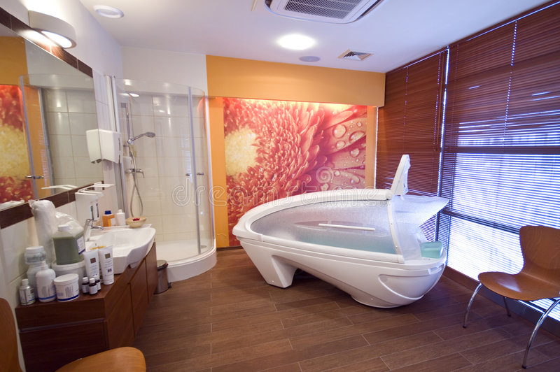 Massage cabin. A modern massage room with a comfortable cabin, a shower and cosmetics stock images