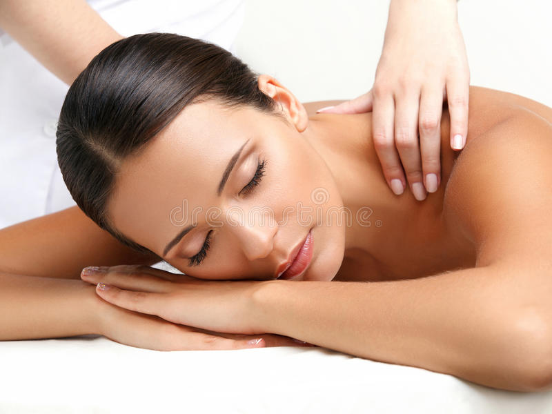 Massage. Close-up of a Beautiful Woman Getting Spa Treatment royalty free stock images