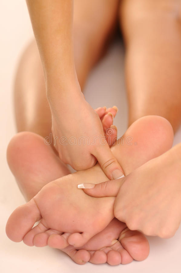 Massage der Fahrwerkbeine stockbild
