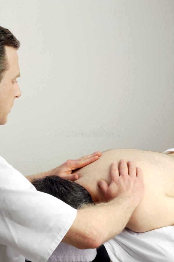 Massage du torse photo libre de droits