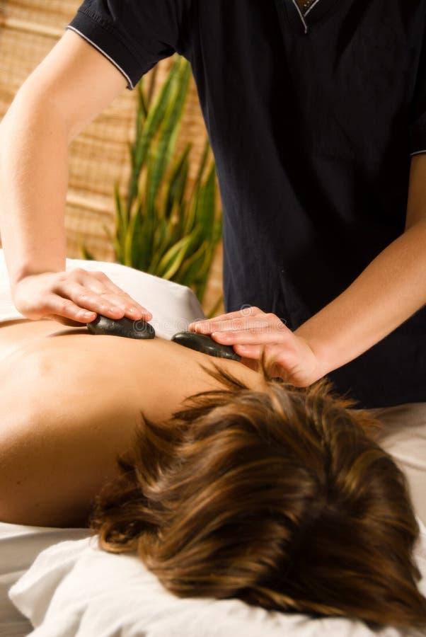 Massage en pierre image stock