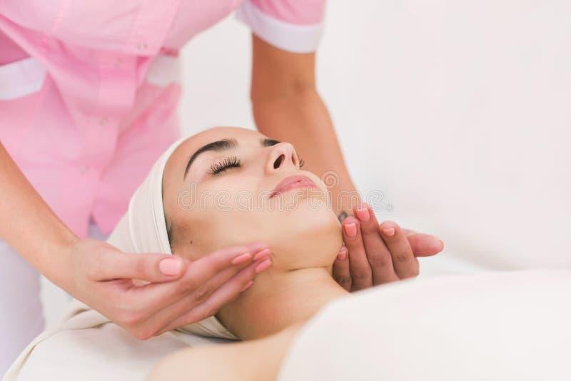 Massage face girl stock photos