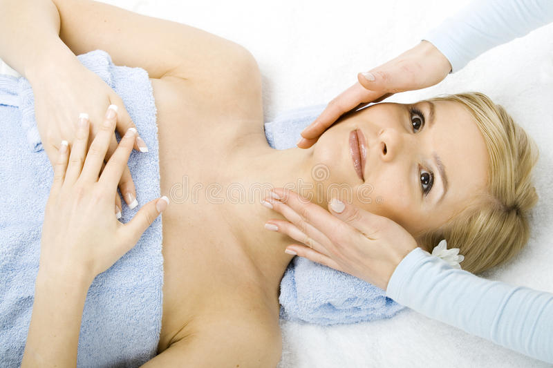 Massage of face for woman in spa stock photography