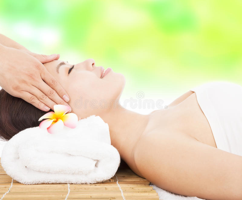 Massage of face for woman in spa salon royalty free stock photography