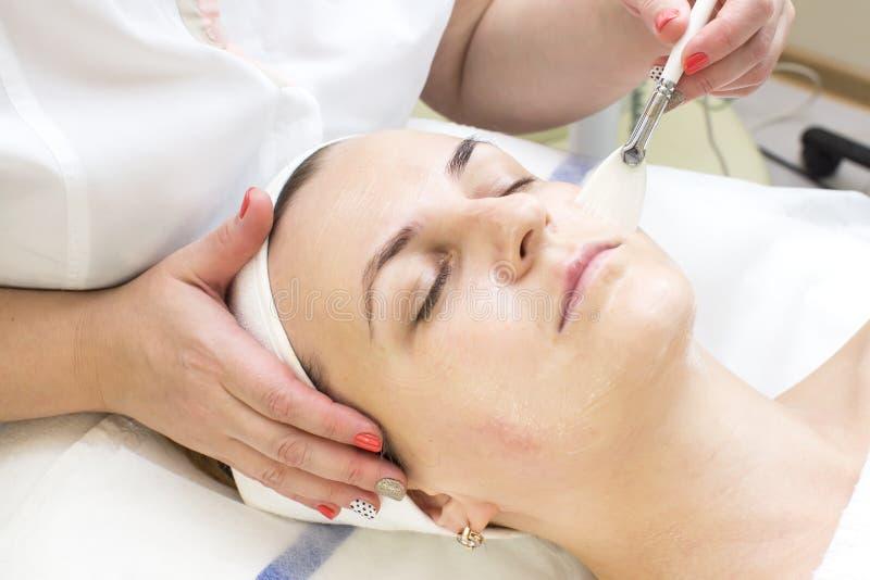 Massage and facial peels. At the salon cosmetics royalty free stock photo