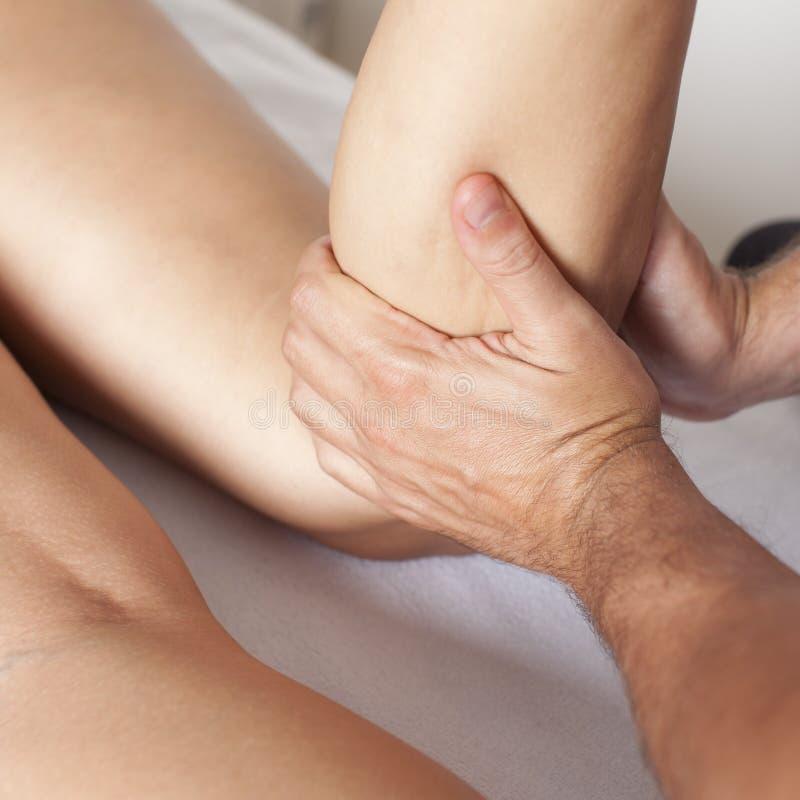 Massage of a female calf muscle. Massage of a woman's calf muscle stock photo