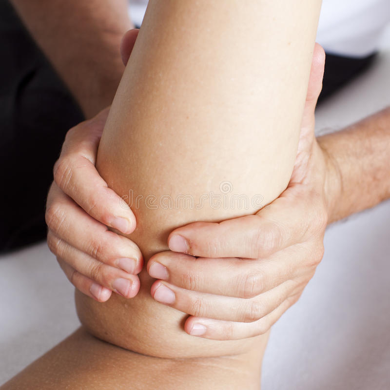 Massage of a female calf muscle. Massage of a woman's calf muscle royalty free stock images