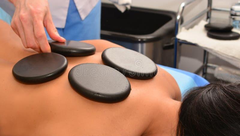 Massage with hot stones stock photo