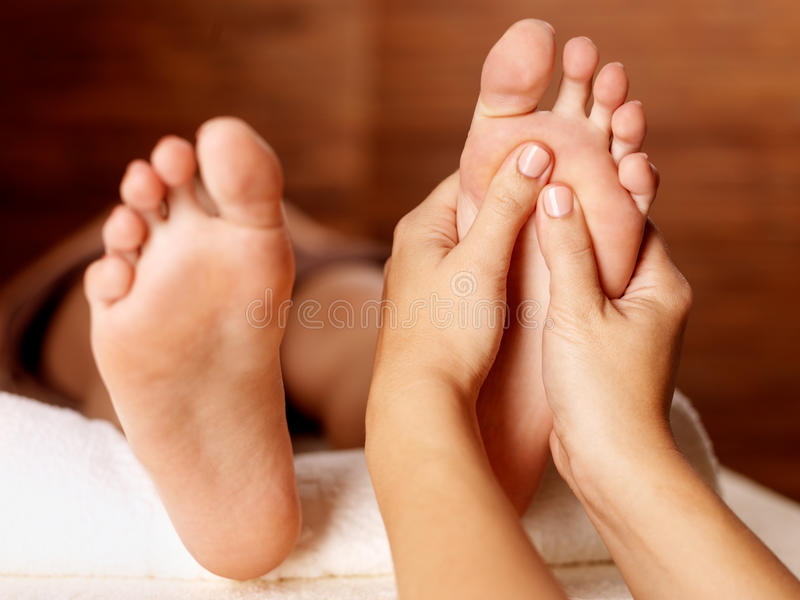 Massage of human foot in spa salon. Soft focus image
