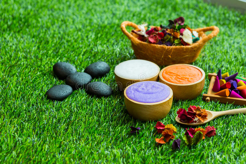 Massage item setting on green grass Background stock images