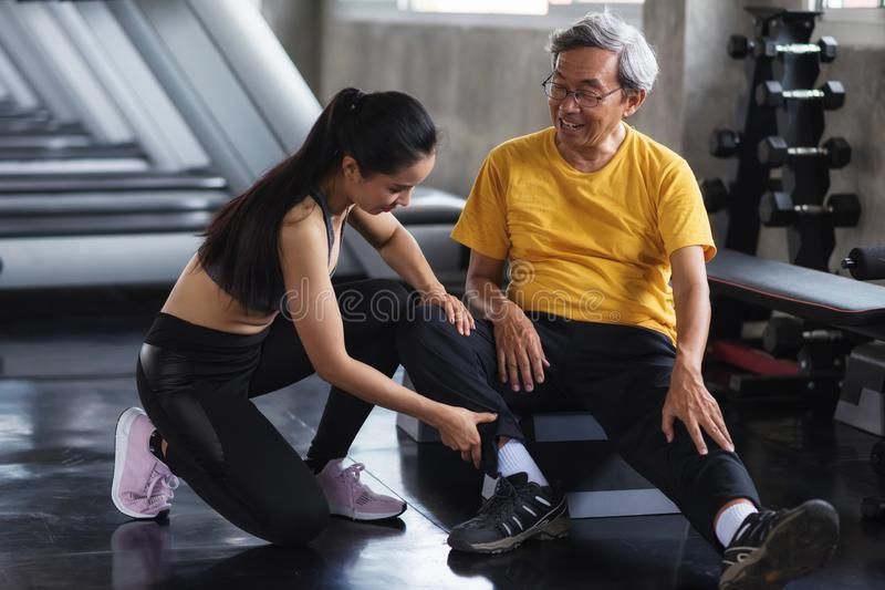 massage leg of old man after work out stock photo