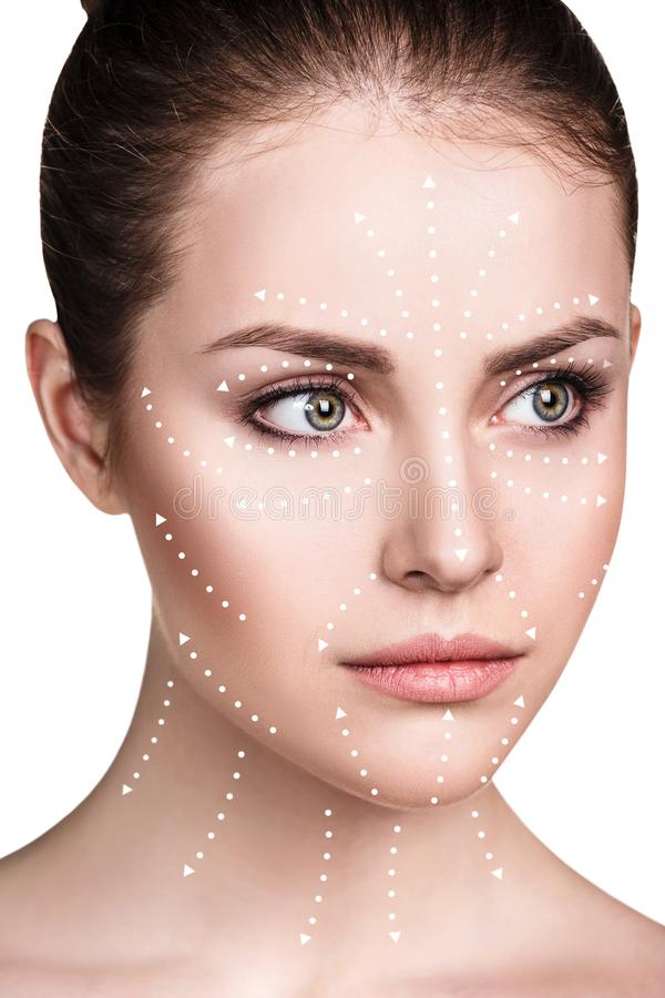 Massage lines on beautiful female face show directions. stock images