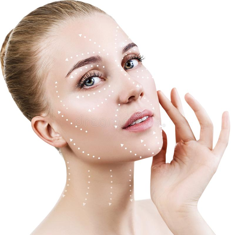 Massage lines on beautiful female face show directions. royalty free stock photo