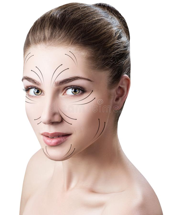 Massage lines on beautiful woman`s face. royalty free stock photography